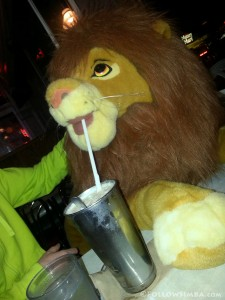 The Lion King - Adult Simba plush drinking a milkshake.